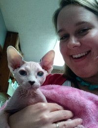woman holding hairless cat