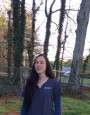 Woman outdoors in veterinary scrubs